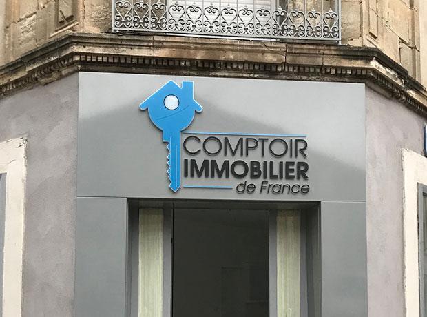 Création d'une arche en tôle tablette + logo lumineux - Comptoir immobilier de France